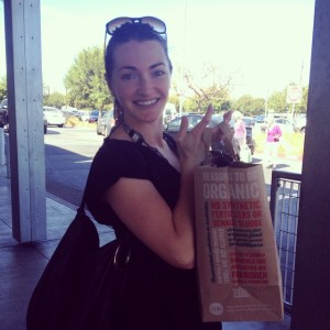 Kate with a bag full of goodies from Whole Food Market